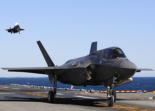 US Navy 111015-N-UM734-913 BF-04, front, a Marine Corps variant of the F-35B Lighting II Joint Strike Fighter, maneuvers after a vertical landing a