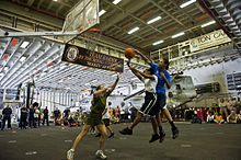US Navy 120121-N-DX615-138 Operations Specialist 1st Class Lisa Moore blocks a shot during a 3-on-3 basketball tournament aboard the amphibious ass.jpg