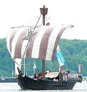 Colour photograph of a small medieval-era single-masted sailing ship
