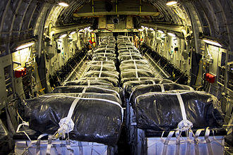 Military intervention against ISIL - Bottled water containers are loaded on a U.S. Air Force C-17 for an airdrop on 8 August 2014.