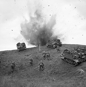 168th (2nd London) Brigade - Universal Carriers and infantrymen of the 10th Battalion, Royal Berkshire Regiment advance 'under fire' during training near Sudbury, Suffolk, 10 June 1942.