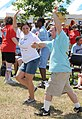 Vanessa Vanossenbruggen, left, dances with athlete John Toche during a karaoke event in the Olympic Village during the Mississippi Special Olympics Summer Games at Keesler Air Force Base, Miss., May 14, 2011 110514-F-BD983-003.jpg