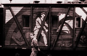 "Agit-train - Section of a painted car of a Soviet ""agit-train"" from a 1921 newsreel."