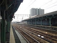 View of Omura Line from platform 4 of Haiki Station (South).JPG
