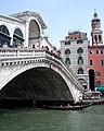 View of Rialto Bridge with a gondola underneath.jpg
