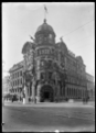 View of the Public Trust Office building in Wellington, decorated for the visit of the Prince of Wales in 1920. ATLIB 293530.png