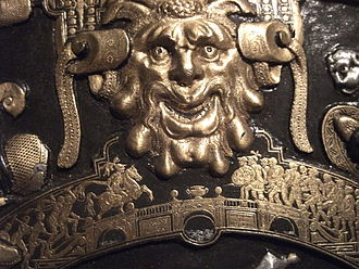 Horatius Cocles - Detail from the Ghisi Shield in the Waddesdon Bequest; a grotesque head in the larger scale above Horatius at the bridge in the smaller
