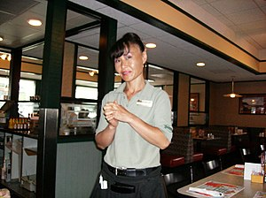 Emotional labor - A waitress at a restaurant is expected to do emotional labor, such as smiling and expressing positive emotion towards customers