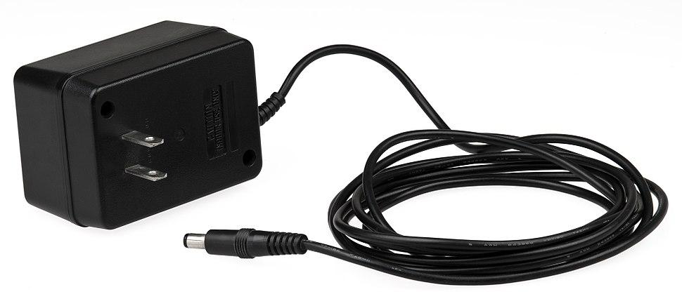 AC adapter with integrated plug pins matching an unpolarized NEMA 1-15P.