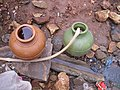 Water containers in slum near Bangalore (3234106664).jpg