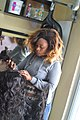 Woman Weaves Hair in Salon 02.jpg