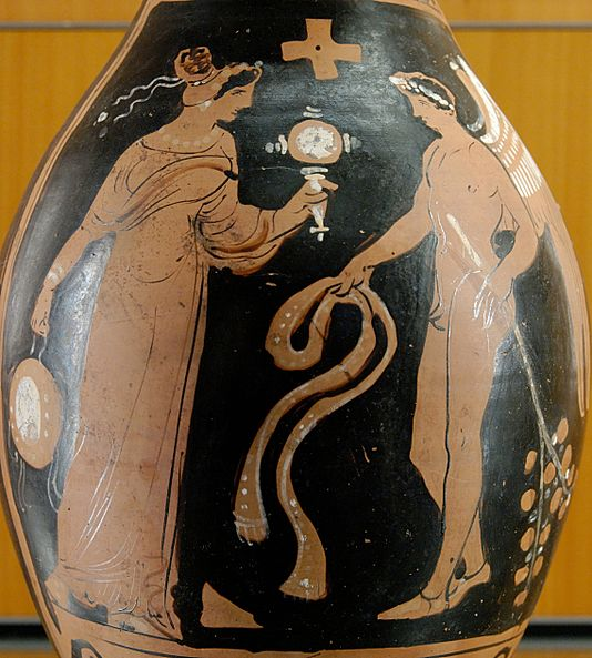 Winged genius facing a woman with a tambourine and mirror, from southern Italy, about 320 BC. Woman mirror tambourine MBA Lyon L631.jpg