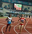 Women 4x100m Relay Dutee Chand In Action 2017 cropped.jpg