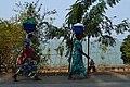 Women walking along the Kivu lake in Gisenyi.jpg