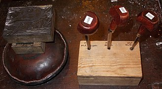 Wood engraving - Leather-covered sandbag, wood blocks and tools (burins), used in wood engraving