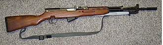SKS - Yugoslavian M59/66 with the muzzle formed into a spigot-type grenade launcher and a folding ladder grenade sight behind the front sight.