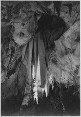 """Onyx drapes in the 'Papoose Room,' Carlsbad Caverns National Park,"" New Mexico. (vertical orientation), 1933 - 1942 - NARA - 520041.tif"