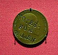 """""""Votes for Women"""", a penny defaced by Suffragettes, UK, 1930 or later. One penny of Edward VII, obverse, copper, 1903. On display at the British Museum.jpg"""