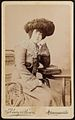 """Wife of Dad's friend Willie"" with a very fine hat ca 1899 (8027697137).jpg"
