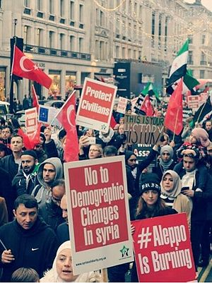 "Turkish diaspora - Syrian Turks waving Turkish and Syrian flags whilst shouting slogans: ""No To Demographic Changes in Syria' and 'No To Genocide' during the December 2016 protests in London."