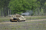 1-118th Combined Arms Battalion fires newly acquired Abrams 140414-Z-ID851-003.jpg