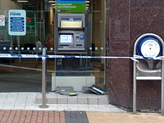 This ATM has been left damaged by rioting. Image: Clare Lovell.