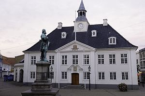 Randers - The old Town Hall on the square in Randers with a statue of Niels Ebbesen in the foreground.