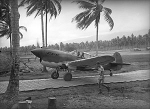 "Marston Mat - A Curtiss P-40 Warhawk piloted by Squadron Leader Keith ""Bluey"" Truscott of No. 76 Squadron RAAF taxiing along Marston Mat at Milne Bay, Papua New Guinea in September 1942"