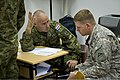 A Croatian soldier, left, confers with a U.S. Soldier assigned to the Joint Multinational Readiness Center in Hohenfels, Germany, during exercise Immediate Response 2013 in Zagreb, Croatia, Aug. 25, 2013 130825-A-WB953-046.jpg