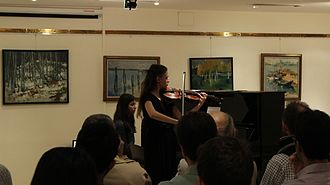 Bilkent University - A student from the Faculty of Music and Performing Arts, performing in the Bilkent University Library Art Gallery.