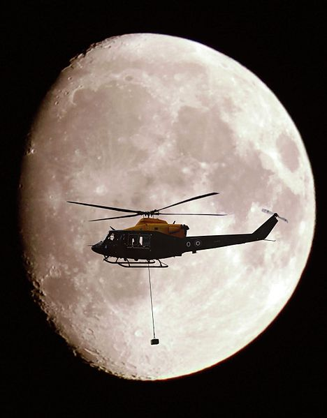 File:A Griffin Helicopter, with an underslung load, shown in silhouette against a full moon.jpg