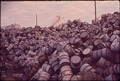 A MOUNTAIN OF DAMAGED OIL DRUMS NEAR THE EXXON REFINERY - NARA - 546000.tif