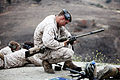 A U.S. Marine Corps scout sniper with Weapons Company, 1st Battalion, 1st Marine Regiment, 1st Marine Division prepares an M40A2 rifle during a known and unknown distance range with Canadian and New Zealand 130612-M-SF473-017.jpg