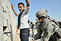 A U.S. Soldier searches an Iraqi boy before allowing him access to the Basra Operations Center during a Medical Civic Assistance Program in Basra, Iraq, March 7, 2011 110307-A-WO967-008.jpg