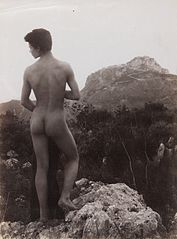 A naked Sicilian boy, in a rocky setting outdoors. Wellcome L0034527.jpg