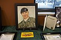 A portrait of U.S. Army Spc. Daniel Lucas Elliott is on display during a building dedication ceremony in his honor at Cary, N.C., June 8, 2013 130608-A-IL912-021.jpg
