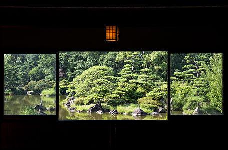 A Japanese garden scene through a window from the Keitaku-en chickee.