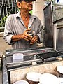 A street vendor making bubble tea in Tan Uyen District, Binh Duong Province, Vietnam (01).jpg