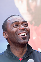 Andy Cole, who is seen smiling, started his professional career at Arsenal, before later finding success at Newcastle and Manchester United.