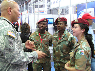 Women in the military by country - Female South African National Defence Force members speak with an American soldier during the Africa Aerospace and Defence expo in 2010.