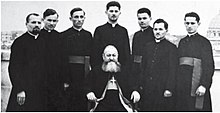 Alexander Ratiu is 5th person from left on back row. Bishop VT Frentiu is sitting.jpg