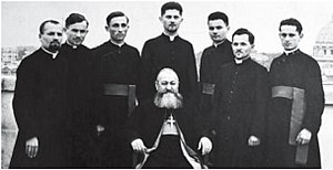 Alexander Ratiu -  Alexander Ratiu is the 5th person from the left to the right on the back row. Bishop Valeriu Traian Frenţiu (1872-1952) is sitting.