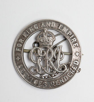 """Silver War Badge - Silver War Badge. Around the rim it says, """"For King and Empire; Services Rendered"""""""