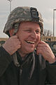 Alfred Meier, the first mayor of Lupburg, Germany, straps on an Army combat helmet to ride in a Humvee during a tour of the Joint Multi-National Regional Command training exercise in Hohenfels at Bavaria 130320-A-WZ615-745.jpg