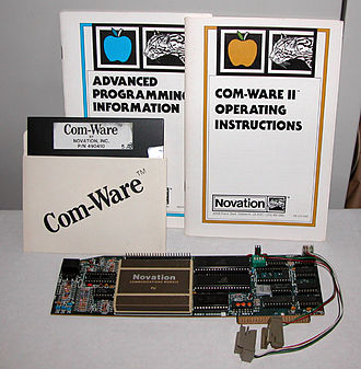 Novation CAT - The Apple-CAT II modem, along with Com-Ware II software and Advanced Programming Information manual.