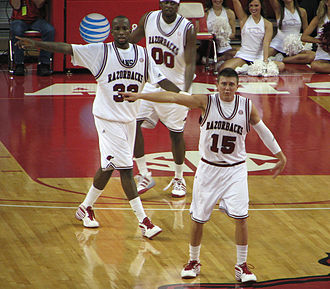 Rotnei Clarke - Clarke (front) and his Arkansas teammates prepare to defend against Morgan State on November 24, 2009