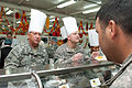 Army Brig. Gen. Bud R. Jameson Jr., the commanding general of the 316th Sustainment Command (Expeditionary) and a resident of Sherwood, Ark., talks with a Soldier before placing turkey on his plate, during 121122-A-XD571-014.jpg