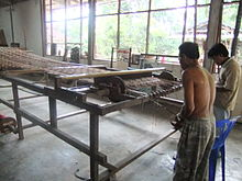 Arranging the thread Tenun Ikat Lombok.JPG