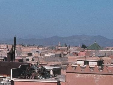 Atlas Mountains over roofs of Marrakech