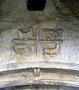 Claveau sculpté primitif représentant les quatre évangélistes, église de Béon.